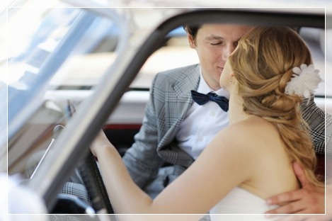 bride and groom in vintage wedding car